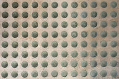 Concrete floor with round glass inlets Royalty Free Stock Photography