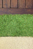 Concrete Floor Timber Decking and Green Artificial Grass Royalty Free Stock Image