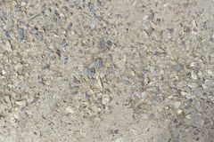 The concrete floor was eroded, saw the sand stone mixture in the background. Concrete floor royalty free stock images