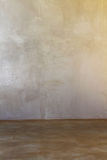 Concrete Floors and Plaster wall, background. Concrete floor stained and polished with matte plaster wall Royalty Free Stock Photography