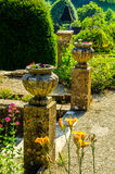 Concrete flower pots in the garden on a pedestal stylized antiqu Stock Images