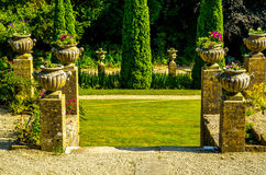 Concrete flower pots in the garden on a pedestal stylized antiqu Stock Photography