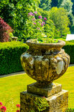 Concrete flower pots in the garden on a pedestal stylized antiqu Royalty Free Stock Photo