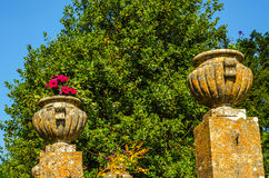Concrete flower pots in the garden on a pedestal stylized antiqu Stock Photos