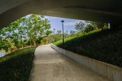 Concrete footpath under hightway bridge in sunny winter afternoo Royalty Free Stock Photos