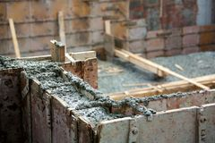 Concrete foundation. Freshly poured concrete foundation for a house under construction Royalty Free Stock Photo