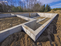 Concrete foundation for a new house. With basement floor exposed Royalty Free Stock Photos