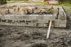 Concrete foundation of new house Stock Photos