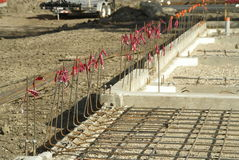 Concrete Foundation Preparatio. Construction site where floor of foundation is yet to be laid, re-bar in place Royalty Free Stock Photos