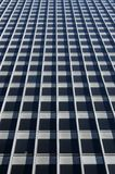 Concrete glass-windowed wall. Of a gray corporate building royalty free stock photo