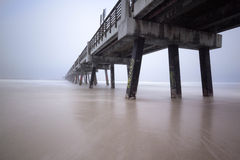 Concrete Graffiti Pier. Concrete Pier with graffiti off of the Atlantic Coast. Located at Jacksonville Beach, FL. Taken on an overcast and foggy morning royalty free stock photos