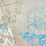 Concrete Graffiti Wall With Peeled Paint And Ripped Ads. Urban Concrete Graffiti Wall With Peeled Paint And Ripped Ads Background Texture stock image
