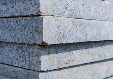 Concrete or granite gray square pavement slabs or stones for floor, wall or path stacked. Industry manufacturing or building conce. Pt stock photo
