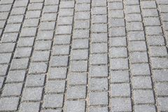 Concrete gray pavement slabs for floor or path. Close up, background or texture stock image