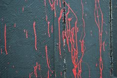 Concrete gray wall, stains of red scarlet paint, graffiti Royalty Free Stock Image