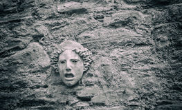 Concrete Greek Mask. A concrete greek mask on the wall Royalty Free Stock Images