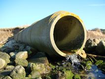 Grey Concrete Cement Drain Pipe with Water Flow Stock Photos
