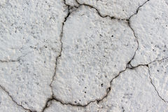 Concrete grey wall with cracks Stock Photo