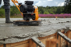 Concrete grinding. Concrete trowelling machine in action Royalty Free Stock Photo