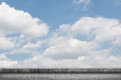 Concrete ground with cloudy sky Stock Photography