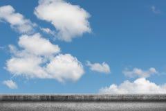 Concrete ground with cloudy sky Stock Photos