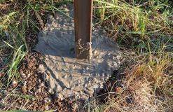 Concrete in the ground for the fence.  stock photography