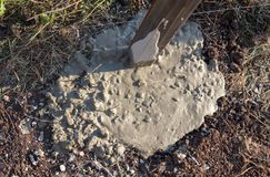 Concrete in the ground for the fence.  royalty free stock image