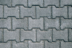 Concrete H shaped paving slabs surface Stock Images