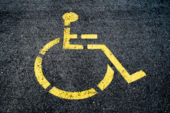Concrete handicapped sign Stock Photos
