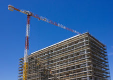 Concrete Highrise Construction. Site and Tower Crane Royalty Free Stock Photo