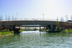 Concrete highway bridge over water at sunny winter noon Stock Photo