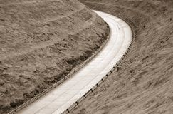 Concrete highway corner. Highspeed concrete highway turn in monochrome color royalty free stock images