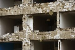 Concrete house for demolition without windows Royalty Free Stock Photo