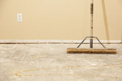Concrete House Floor with Broom Ready for Flooring Installation Royalty Free Stock Photography