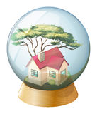 A concrete house inside the crystal ball Stock Image