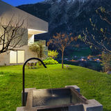 Concrete house with stone fountain Stock Image