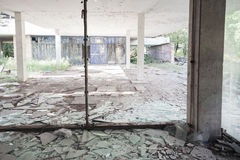 Concrete interior with broken windows Royalty Free Stock Image