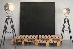 Room with empty chalkboard banner and lighting Stock Image