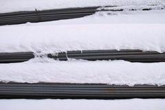 Concrete iron and snow Stock Photos