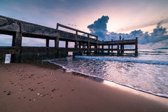 Concrete jetty along side to the sea Royalty Free Stock Photography