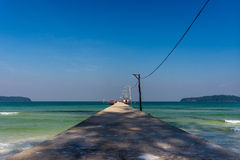 A concrete jetty peir going off in to the distance in to a calm Royalty Free Stock Photo