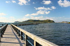 Concrete jetty with railing over sea Royalty Free Stock Photo