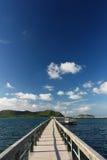 Concrete jetty with railing over sea Stock Photo