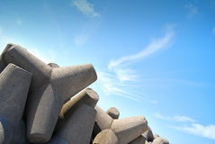 Concrete jetty surrounded by rocks Stock Photography