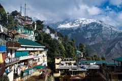 Concrete Jungle of McLeod Ganj, Dharamshala. Concrete jungles are slowly moving towards conquering snow covered mountains of MACLODEGANJ, Dharamshala Stock Photo