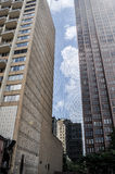 Concrete jungle with a sky gap between the buildings Royalty Free Stock Image