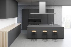 Concrete kitchen interior, gray table close up. Modern kitchen interior with a concrete floor, white walls, black consoles and countertops and a bar stand. 3d Stock Photography