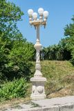 Concrete lamppost with four lamps in the village royalty free stock images