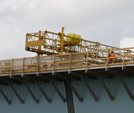 Concrete leveling Machine. Men operating a concrete leveling machine on a new brige under construction Stock Photos
