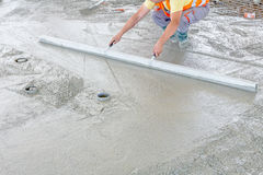 Concrete is leveling after pouring Royalty Free Stock Images
